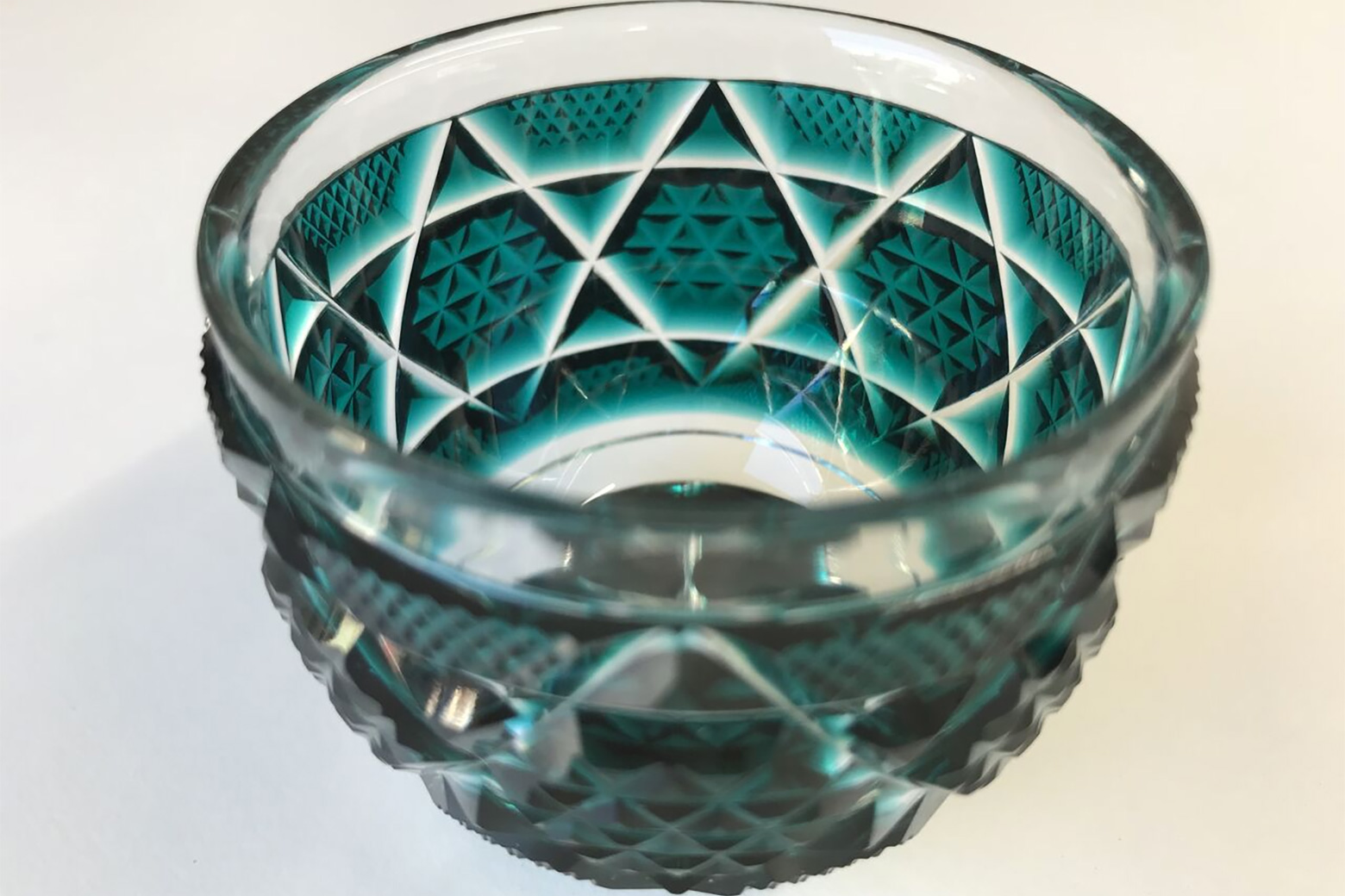 green glass made by japanese technique kiriko