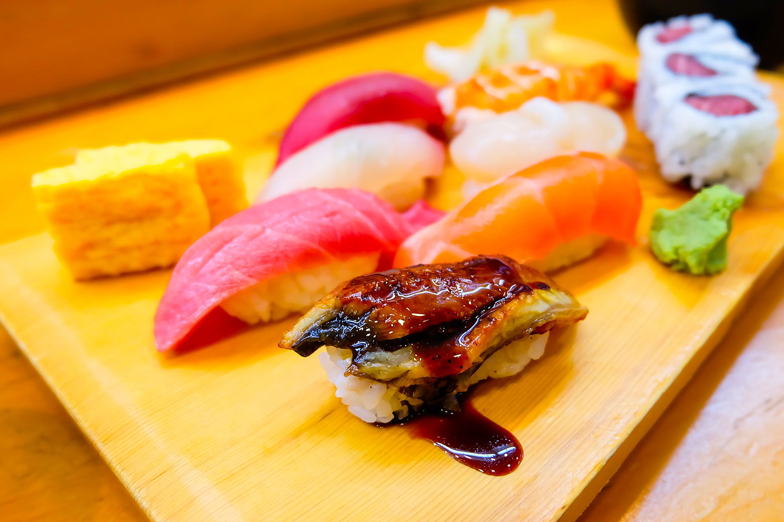 wooden tray with fresh sushi