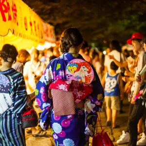 Women wearing the yukata during the matsuri at night