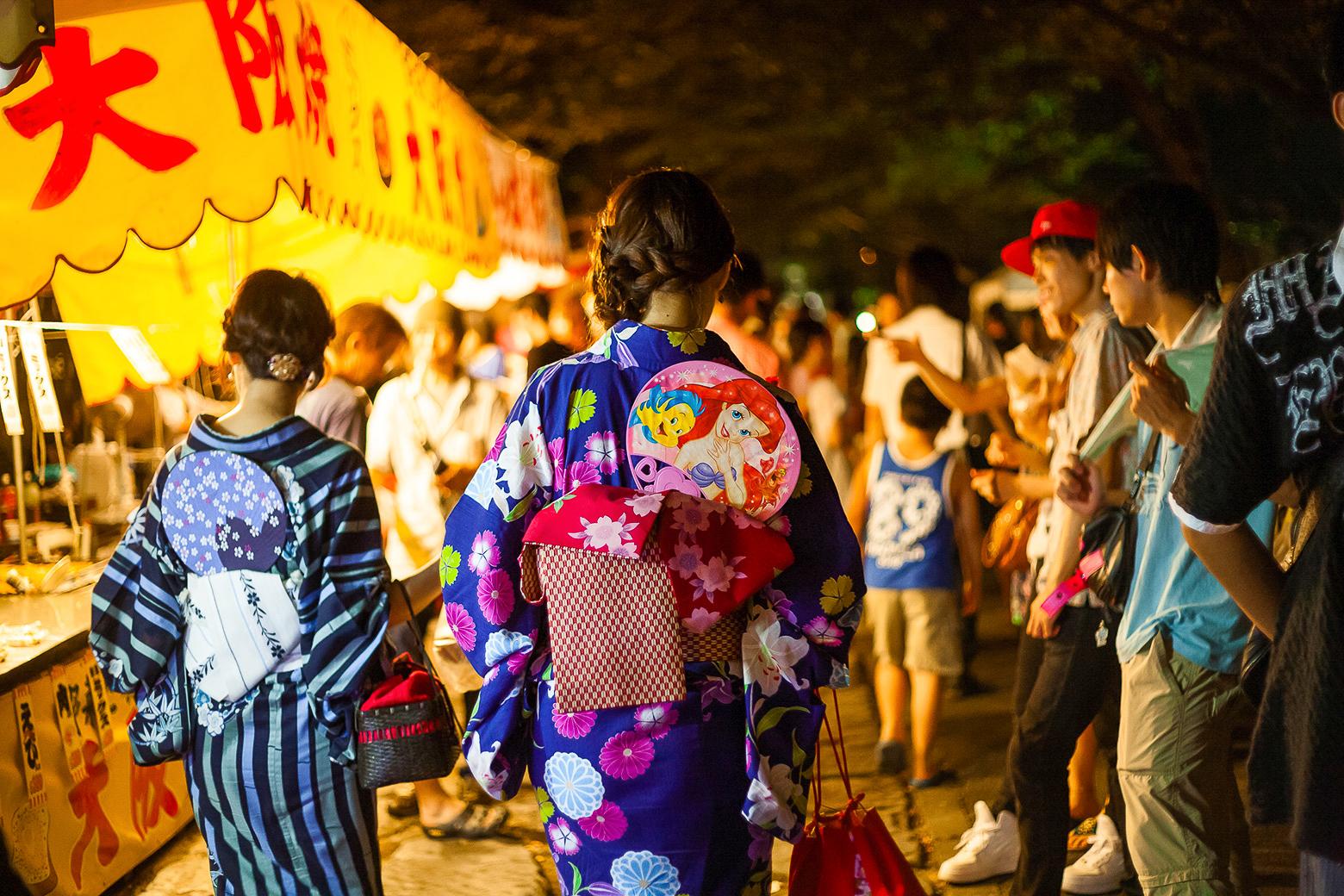 Women wearing the yukata during the matsuri at night